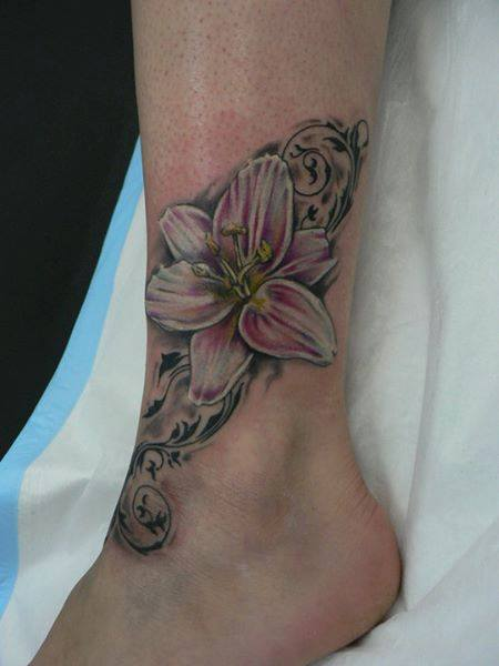 Wonderful Lily Flower Tattoo On Left Foot