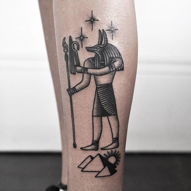 Amazing Black Ink Anubis Tattoo On Left Leg