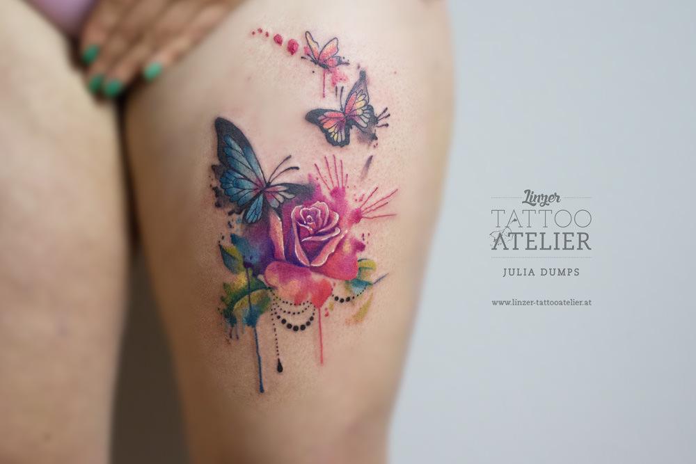 Aqua Rose With Butterflies Tattoo On Women Left Thigh