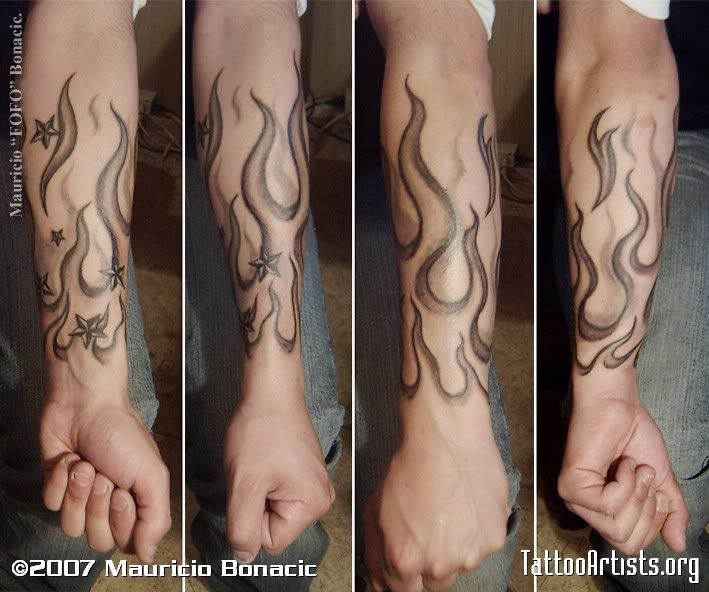 Black And Grey Fire And Flame Tattoo On Left Forearm