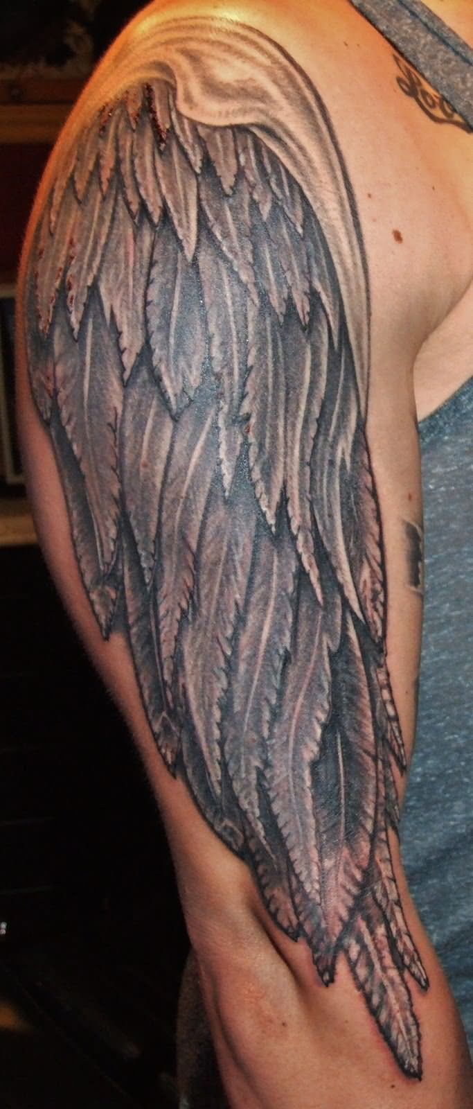 Black And Grey Wing Tattoo On Right Half Sleeve
