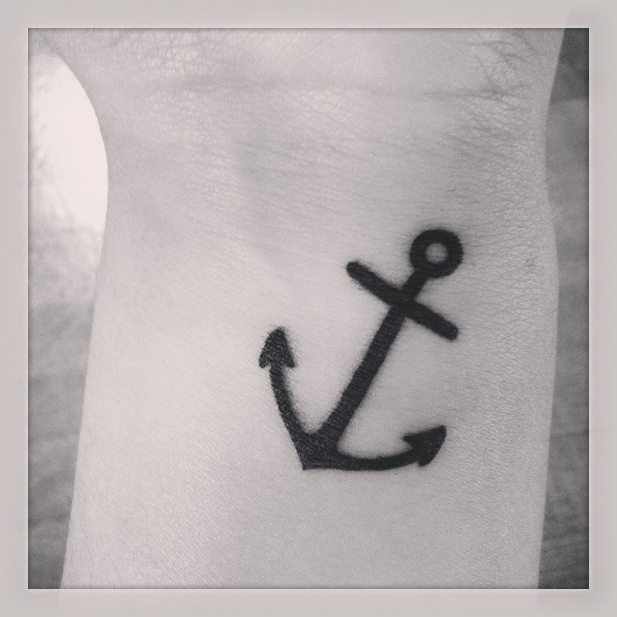 Black Ink Anchor Tattoo On Wrist