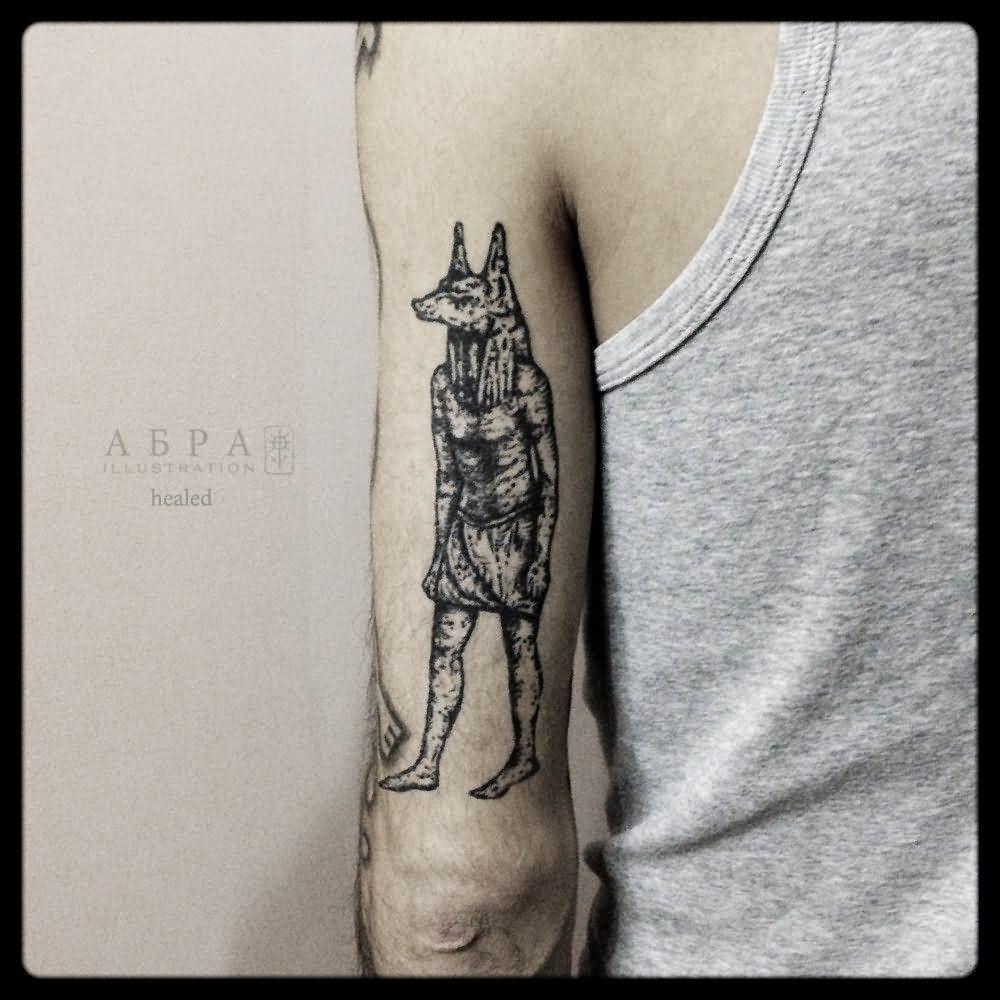 Black Ink Anubis Tattoo On Left Half Sleeve