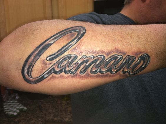 Black Ink Camaro Lettering Tattoo On Right Arm