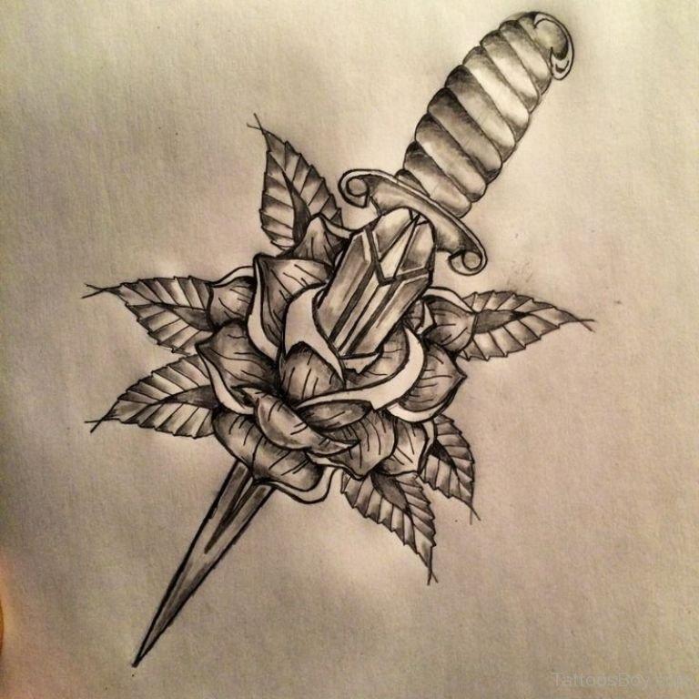 Black Ink Dagger In Rose Tattoo Design