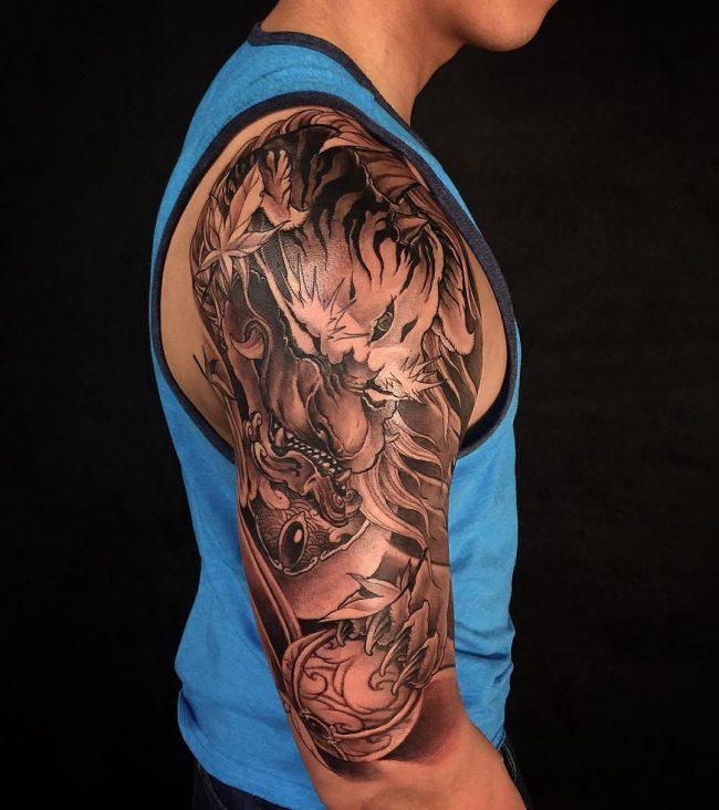Black Ink Foo Dog Head Tattoo On Man Right Half Sleeve