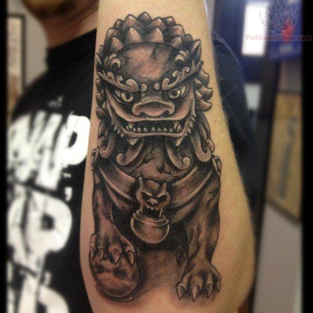Black Ink Foo Dog Tattoo On Left Arm
