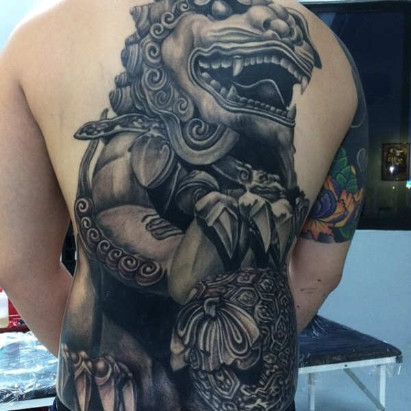 Black Ink Foo Dog Tattoo On Man Full Back