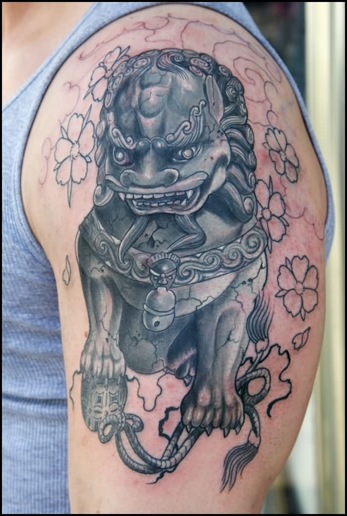 Black Ink Foo Dog Tattoo On Man Left Shoulder