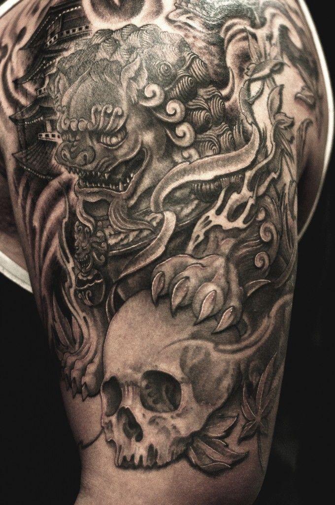 4c2ce937a Black Ink Foo Dog With Skull Tattoo On Man Left Half Sleeve