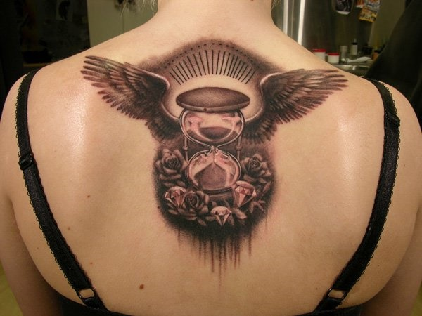 Black Ink Hourglass With Wings Tattoo On Women Upper Back