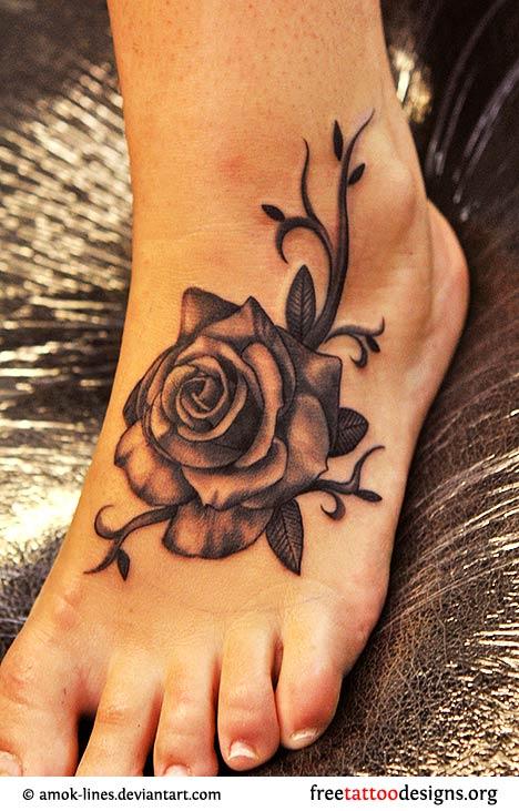 Black Ink Rose Tattoo On Left Foot