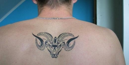 2d18328c0 Black Tribal Aries Head Tattoo On Man Upper Back