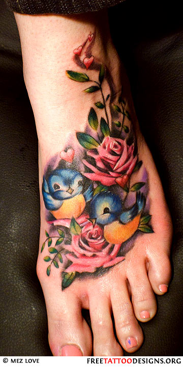 Colorful Birds With Roses Tattoo On Girl Left Foot