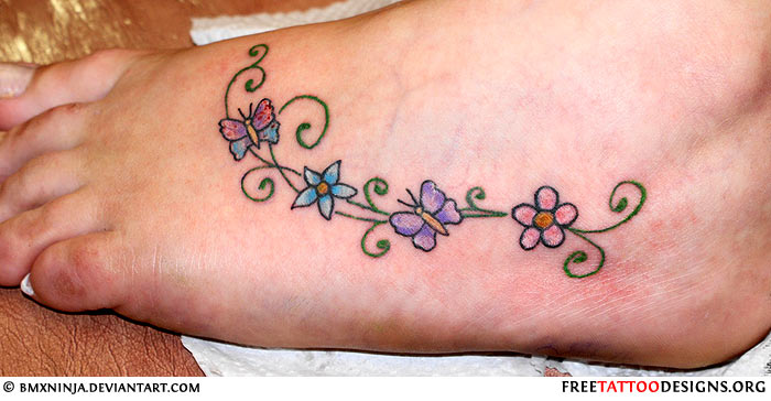 Colorful Flowers With Butterfly Tattoo On Women Left Foot