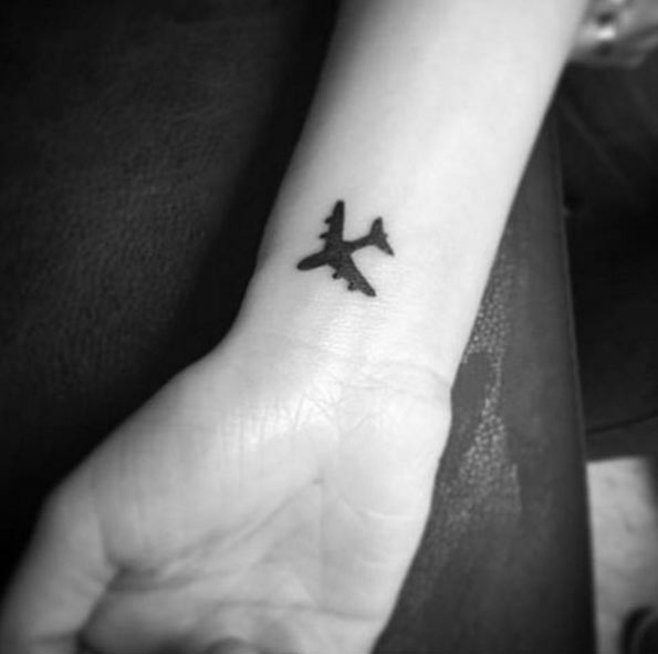 Silhouette Airplane Tattoo On Right Wrist