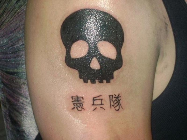 Silhouette Skull Tattoo On Right Upper Arm