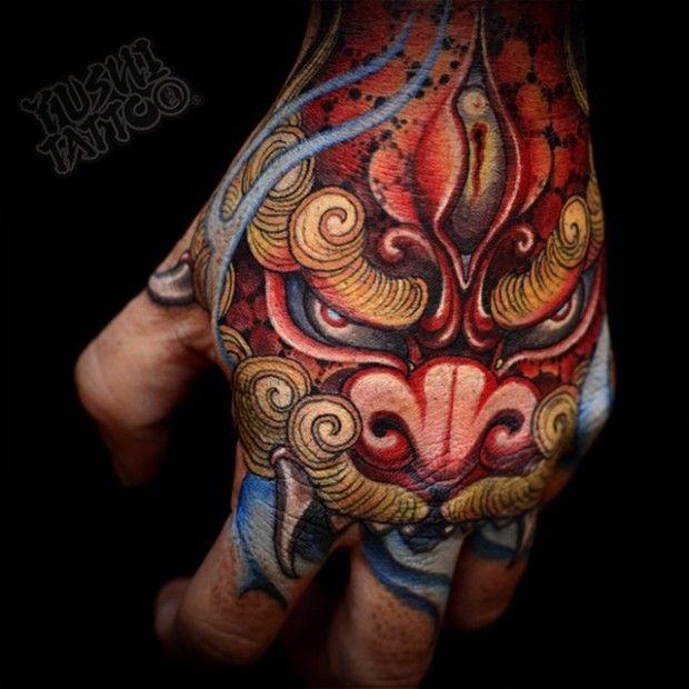 Traditional Foo Dog Tattoo On Man Left Hand