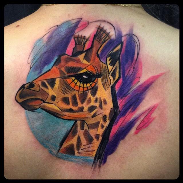 ae89354da Attractive Colorful Giraffe Head Tattoo On Upper Back