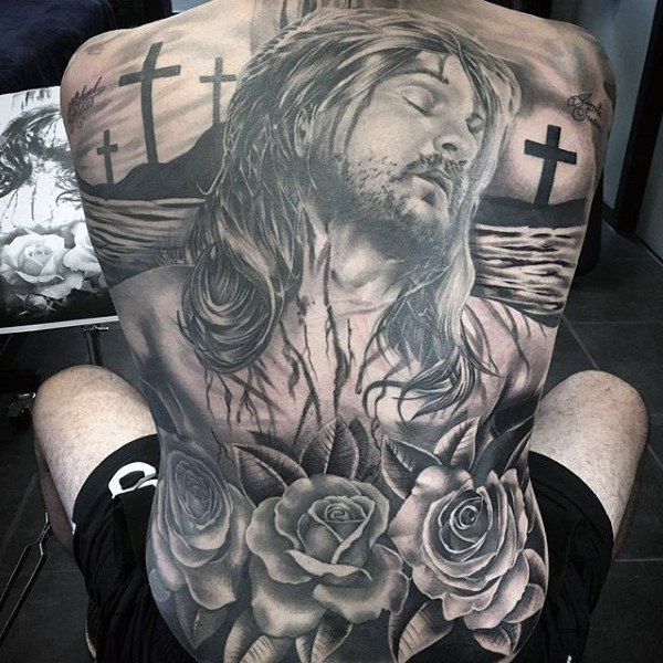 Black ink 3d jesus with roses tattoo on man full back for Tattoos of black jesus