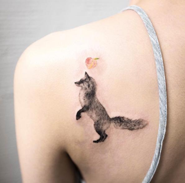 Black Ink Fox Tattoo On Girl Left Back Shoulder