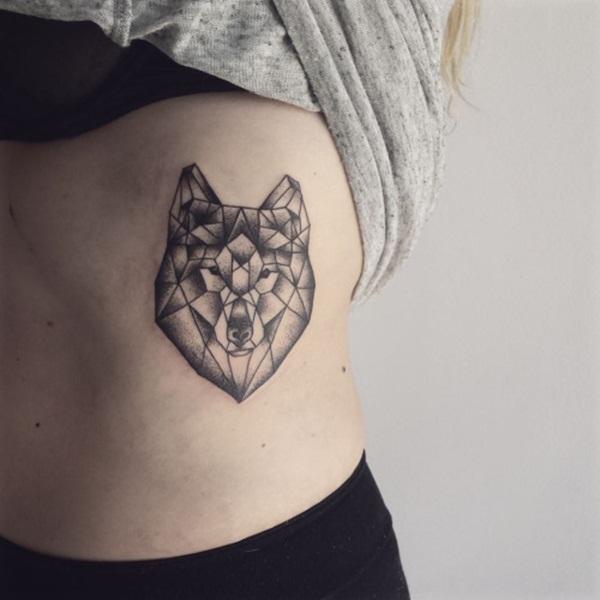 Black Ink Geometric Wolf Head Tattoo On Left Side Rib