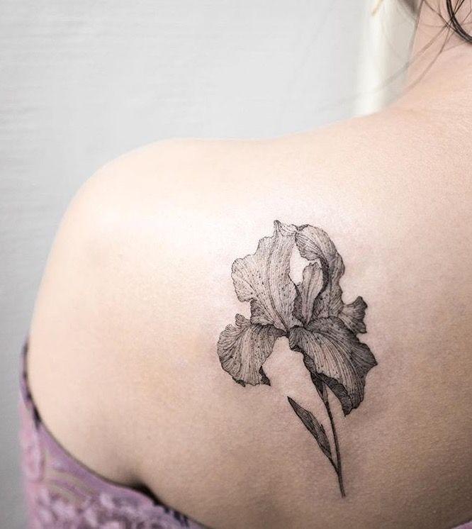 048e57fc73764 Black Ink Iris Flower Tattoo On Girl Left Back Shoulder