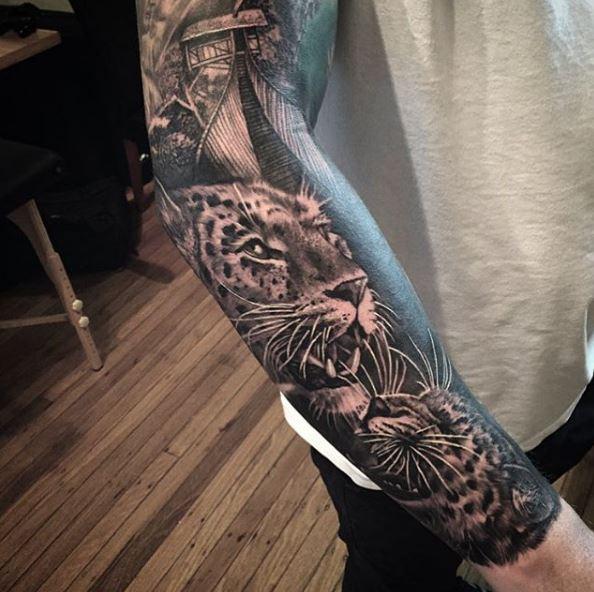 Black Ink Jaguar Tattoo On Right Arm