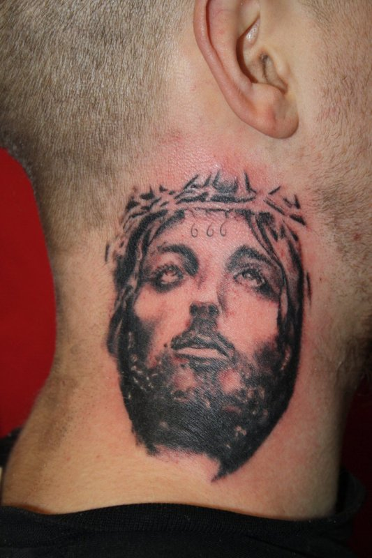 Black ink jesus head tattoo on man side neck for Tattoos on side of head
