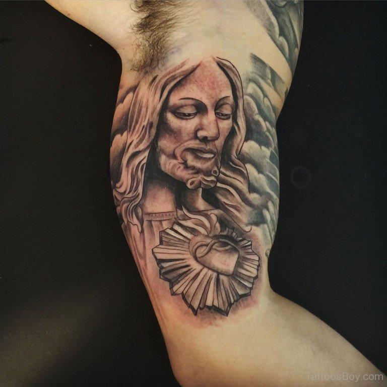 Black ink jesus tattoo on bicep for Tattoos of black jesus