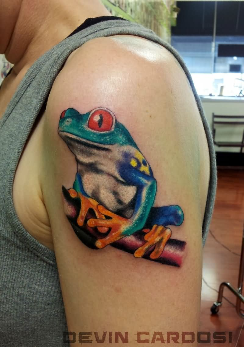 Colorful Frog Tattoo On Man Left Shoulder