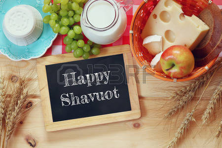 Happy Shavuot Written On Black Board And Fruits Picture