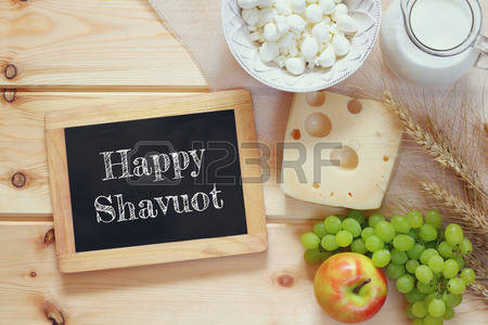 Happy Shavuot Written On Black Board With Fruits