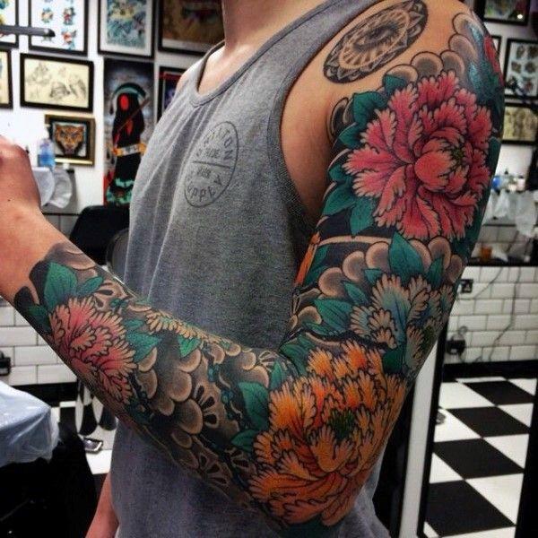 Traditional Japanese Flowers Tattoo On Man Left Full Sleeve