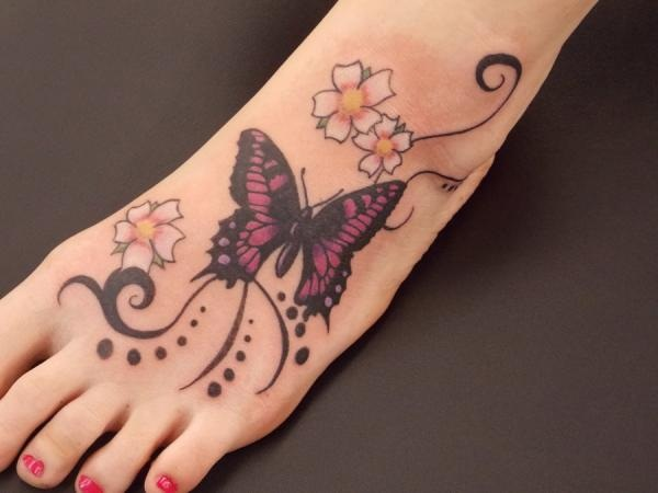 Amazing Flowers And Butterfly Tattoo On Left Foot