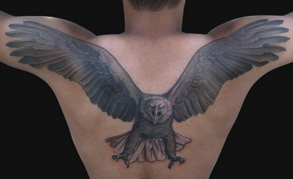 Angry Eagle Flying With Open Wings Tattooed On Man Upper Back