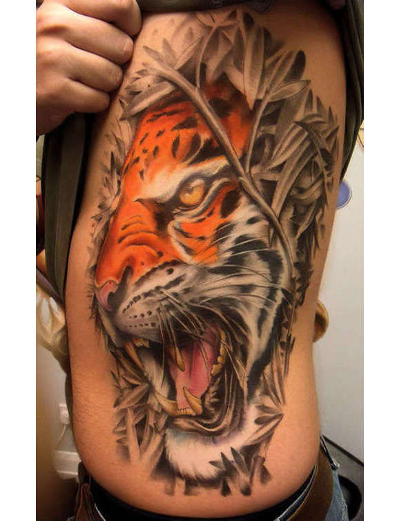 Angry Tiger Head And Grey Leaves Tattoos On Side Rib