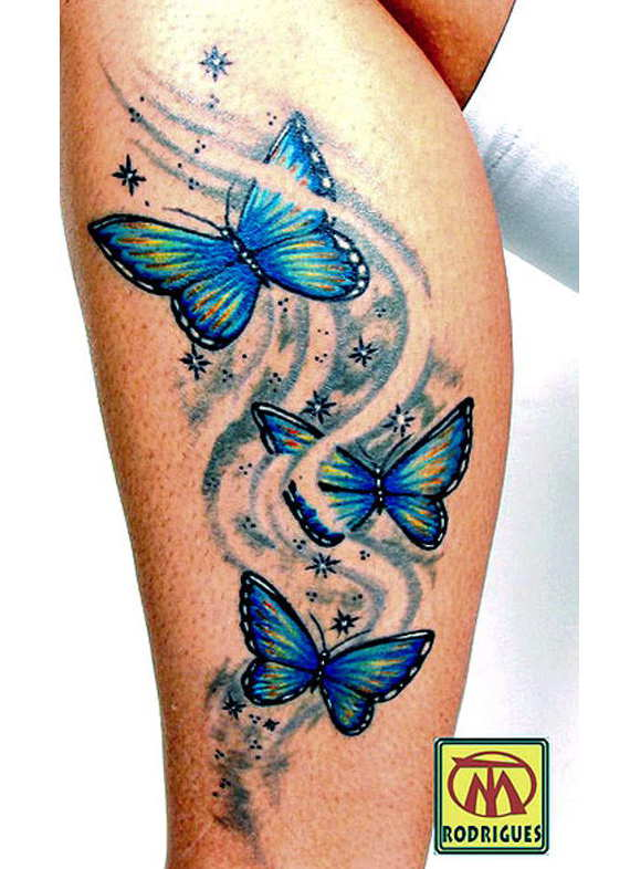 blue and yellow butterfly tattoo on side leg