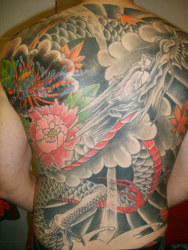 e4f574ea6 Chinese Flowers and Dragon Tattoos On Back by SimplyTattoo