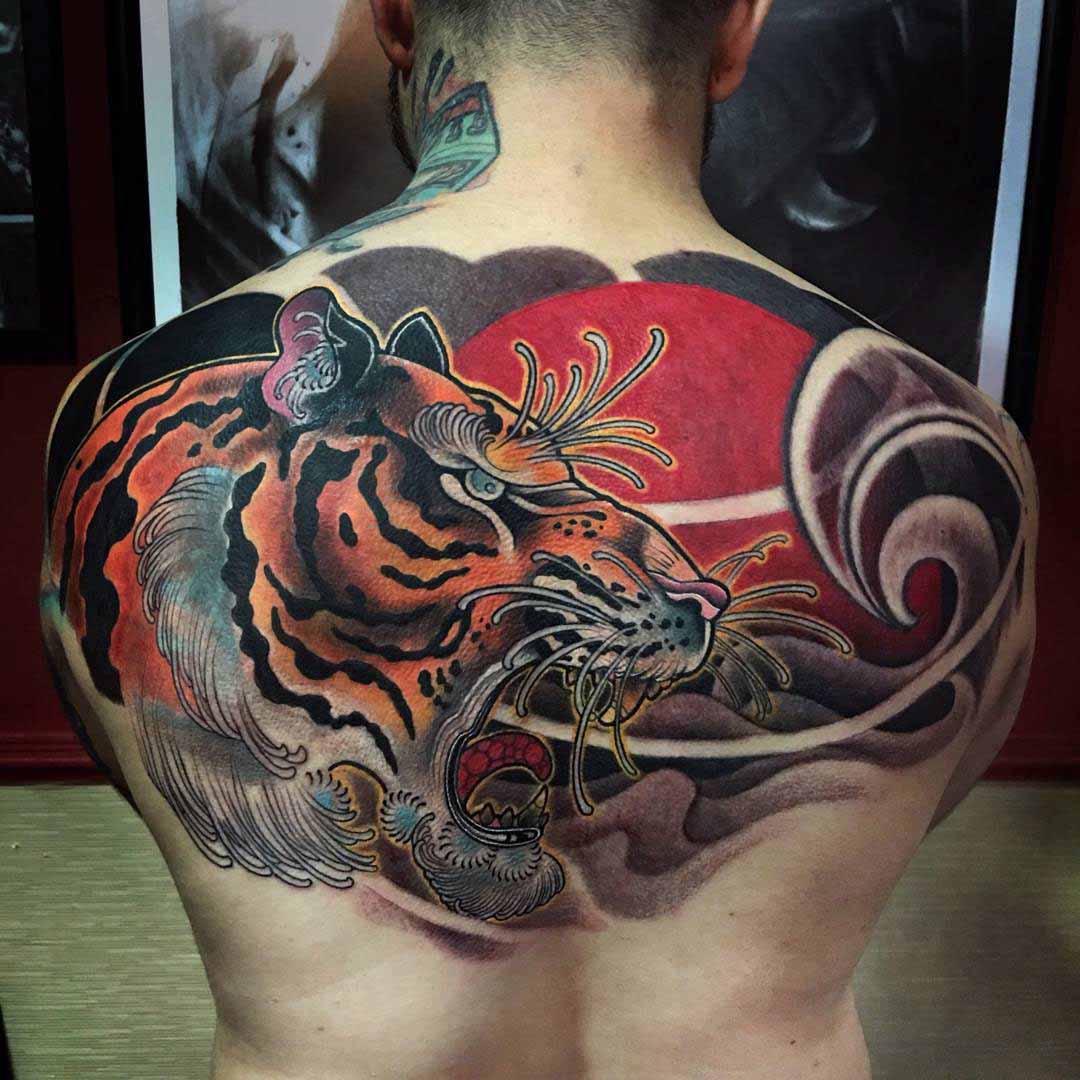 Colored Tiger Head Tattoo On Man Upper Back