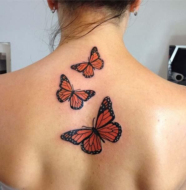 Flying Butterflies Tattooed On Upper Back