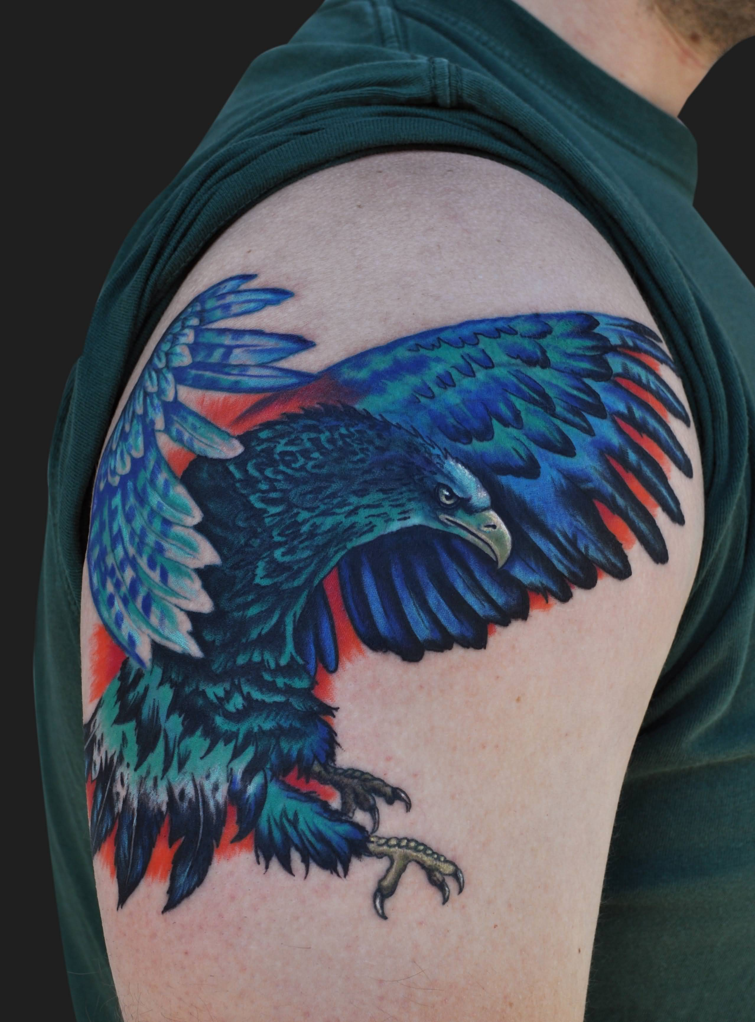 57 latest eagle tattoos ideas with meanings flying eagle tattoo on right shoulder with blue ink biocorpaavc