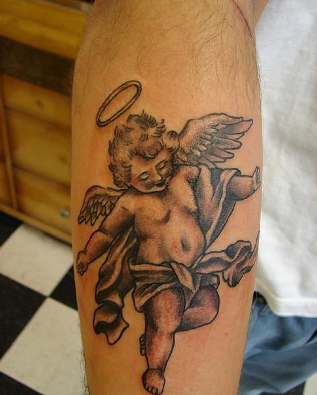 Flying baby angel with holy ring tattoo