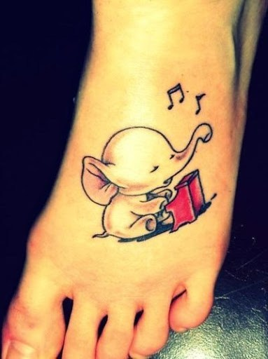 Left Foot Up Trunk Baby Elephant With Music Notes Tattoo On Left Foot