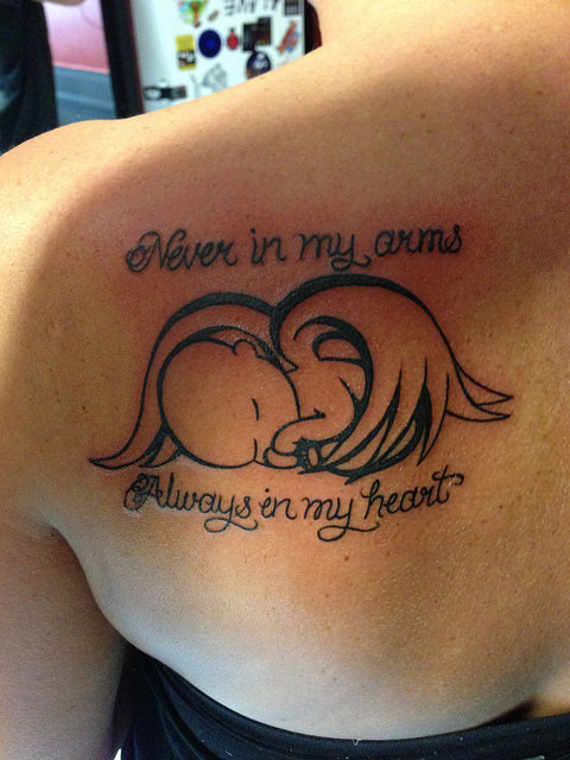 Never in arms - always in my heart - Miscarriage baby angel tattoo