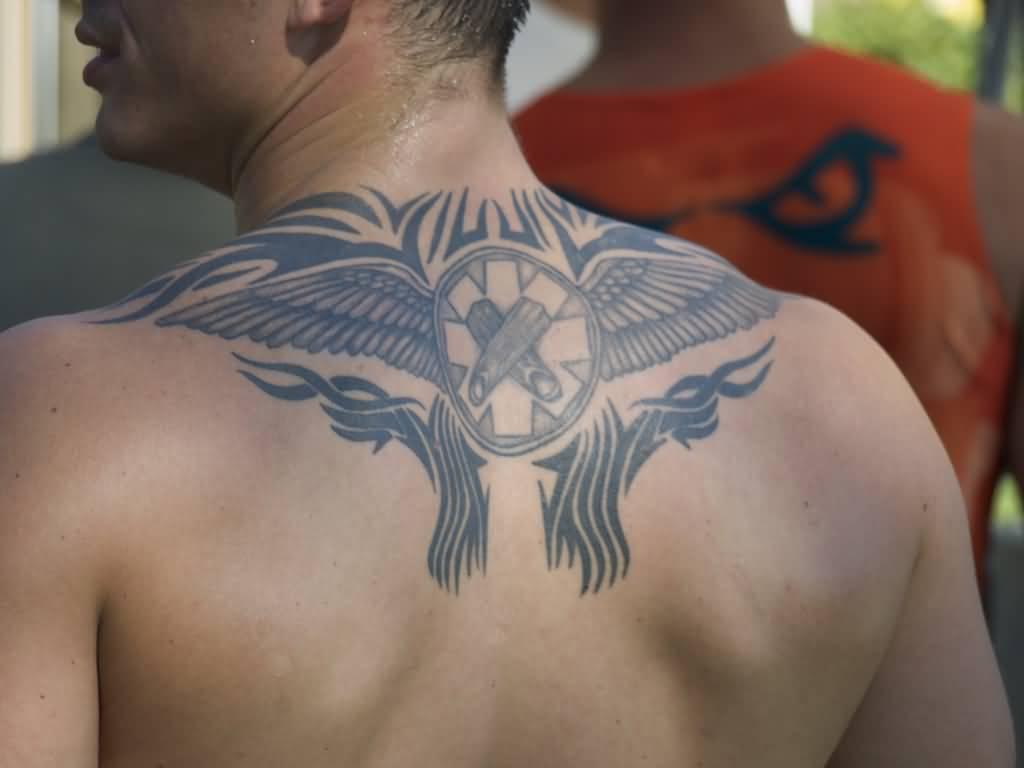 8a0b373b7 Nice Black Tribal Eagle Tattoo On Man Upper Back