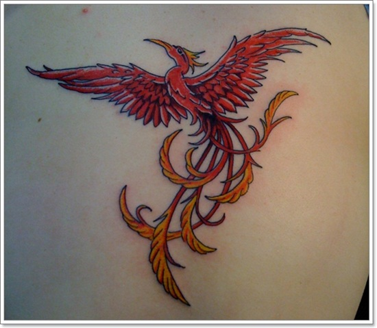 Phoenix Rising From Ashes Tattoo On Back