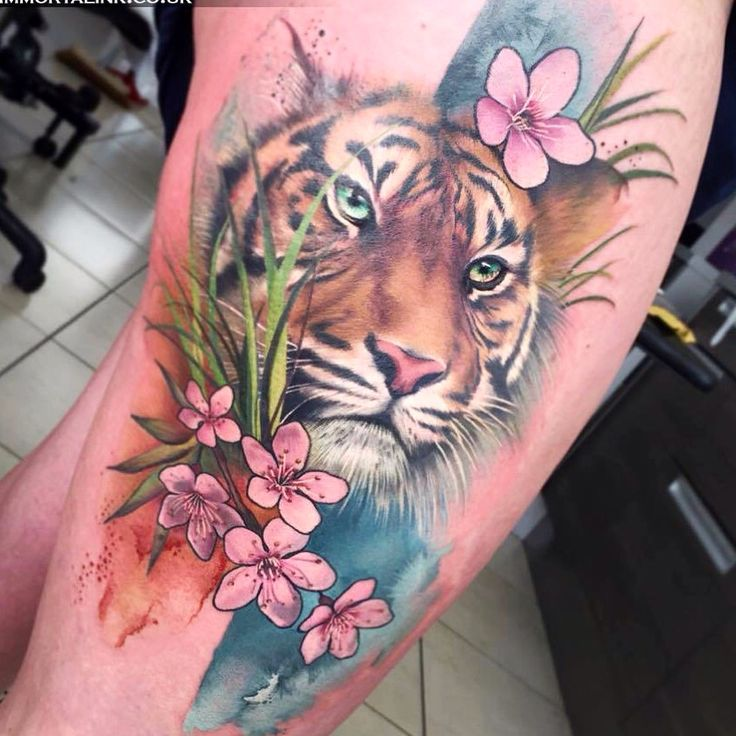 Pink Flowers And Tiger Head Tattoo On Thigh