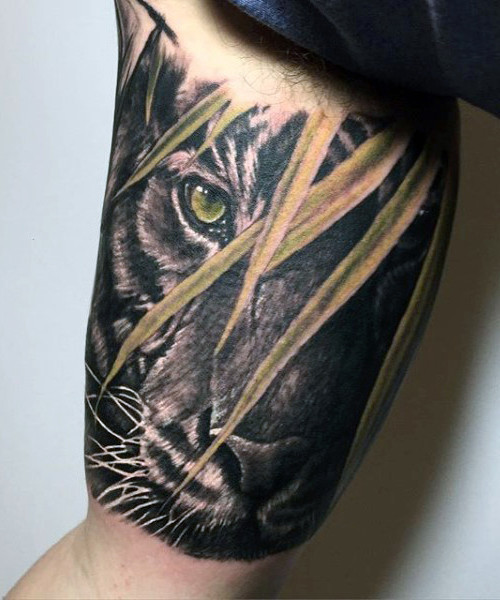 Realistic Black Tiger Face Tattoo On Bicep