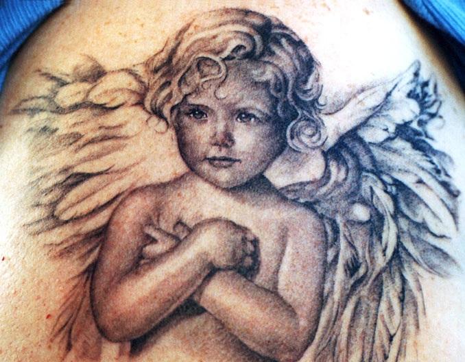 Realistic baby angel tattoo